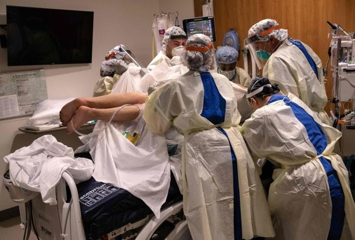 "A ""prone team,"" wearing personal protective equipment (PPE), turns a COVID-19 patient onto his stomach. PIcture: Getty Images"